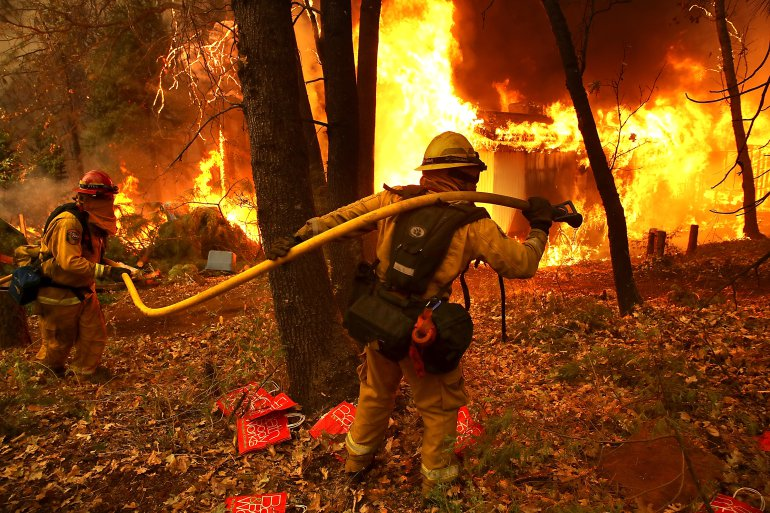 A firefighter goes through an area affected by the California fires.